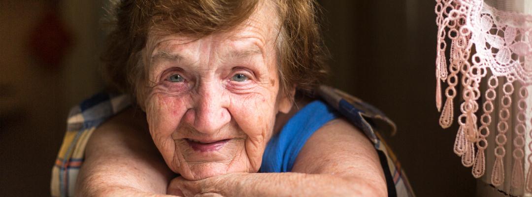 A senior woman smiles.